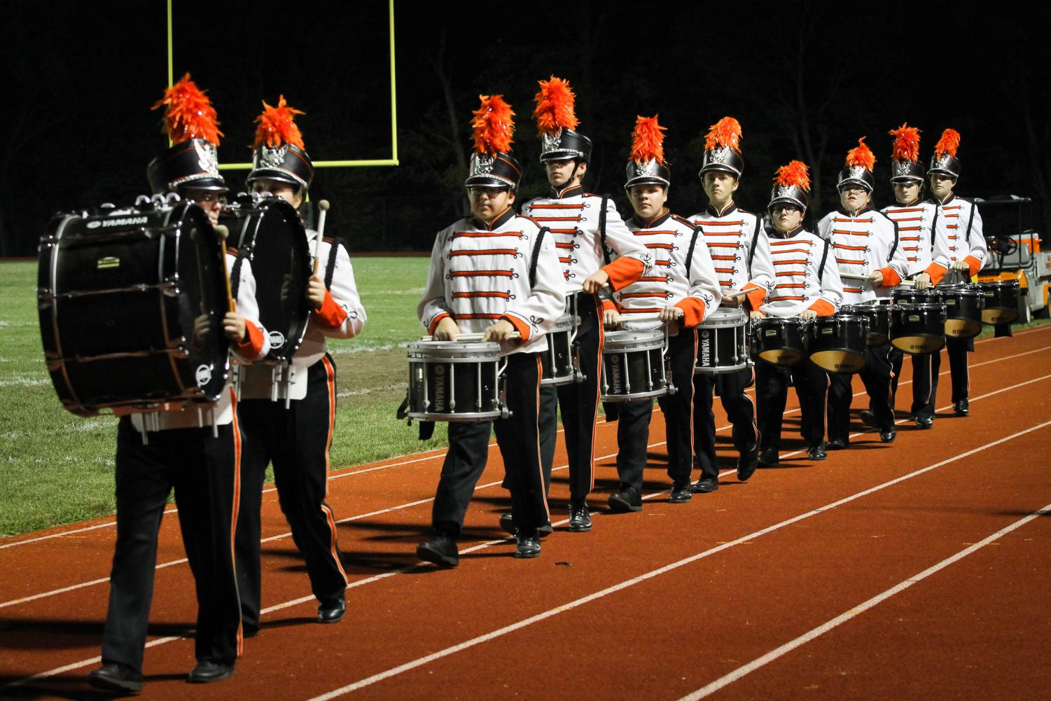 The Marching Rams  perform during the halftime show at the football game against Althoff.
