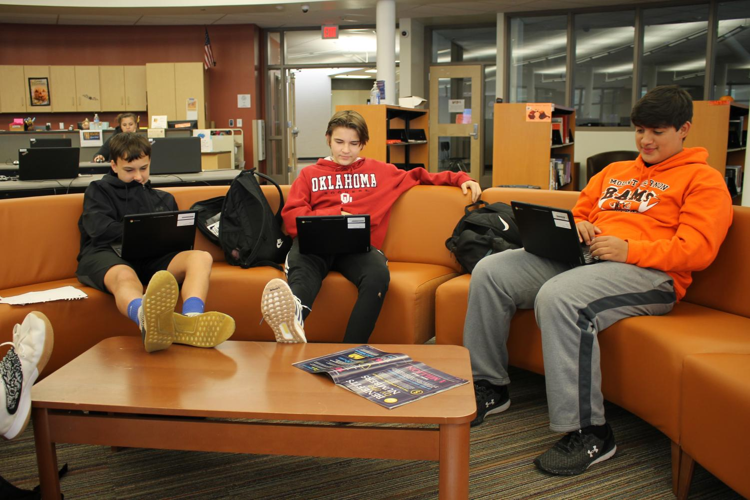 Students work on their Chromebooks in the Media Center. Some students use the Media Center during study hall periods.