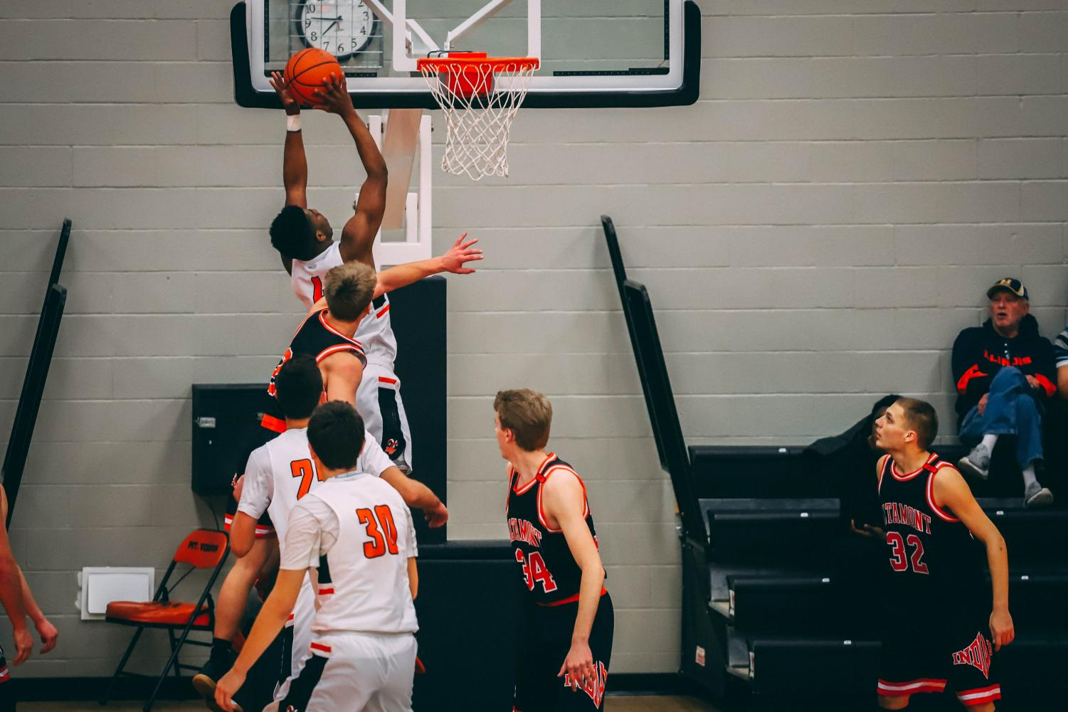 Amir Spann, '20 goes up for a dunk against the Altamont defender. Spann dominated that night with 28 points.