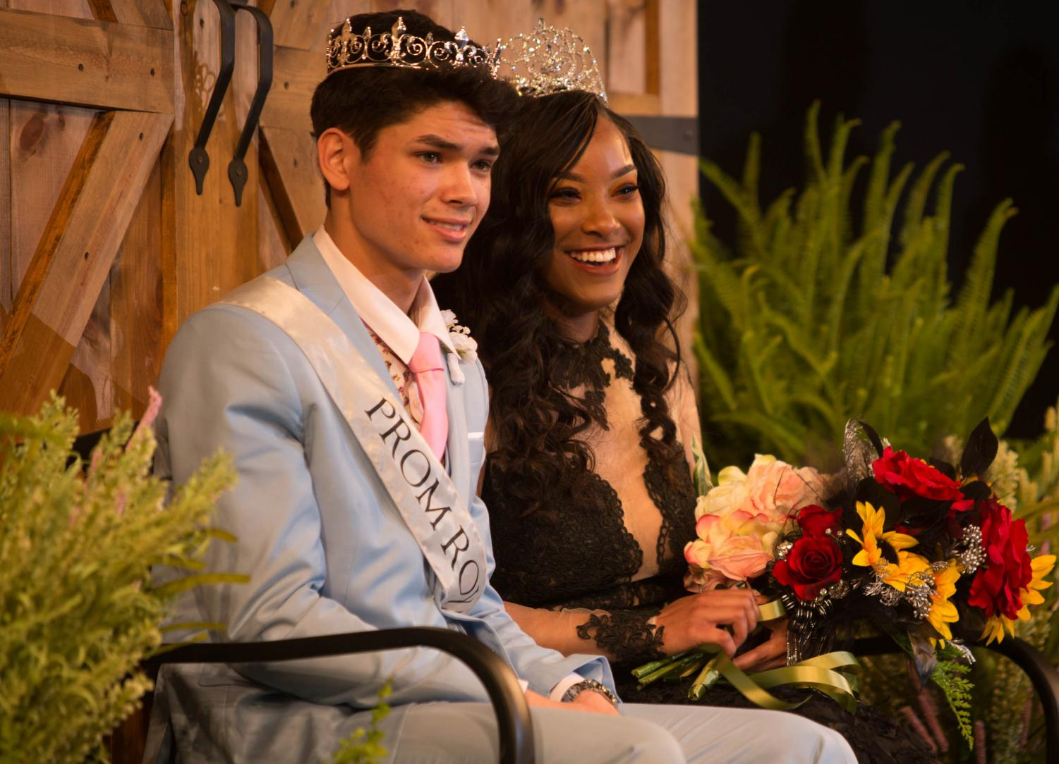 Nick Sursa, '19 and JaMeziah Lesure, '19 bask in royalty on the Schweinfurth stage as they are awarded Prom King and Queen of last year's prom. Sursa and Lesure won the award on Saturday April 14, 2018.